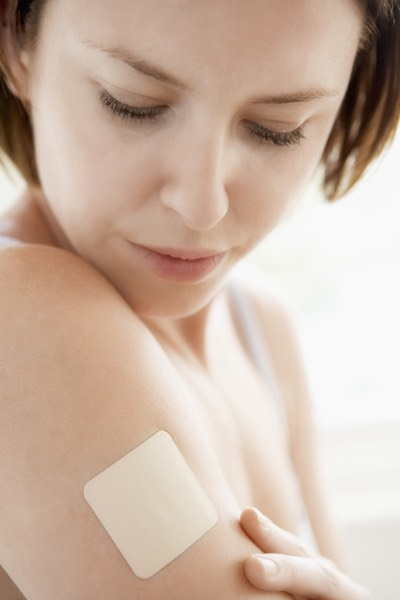 photo of a woman with a nicotine patch on her arm